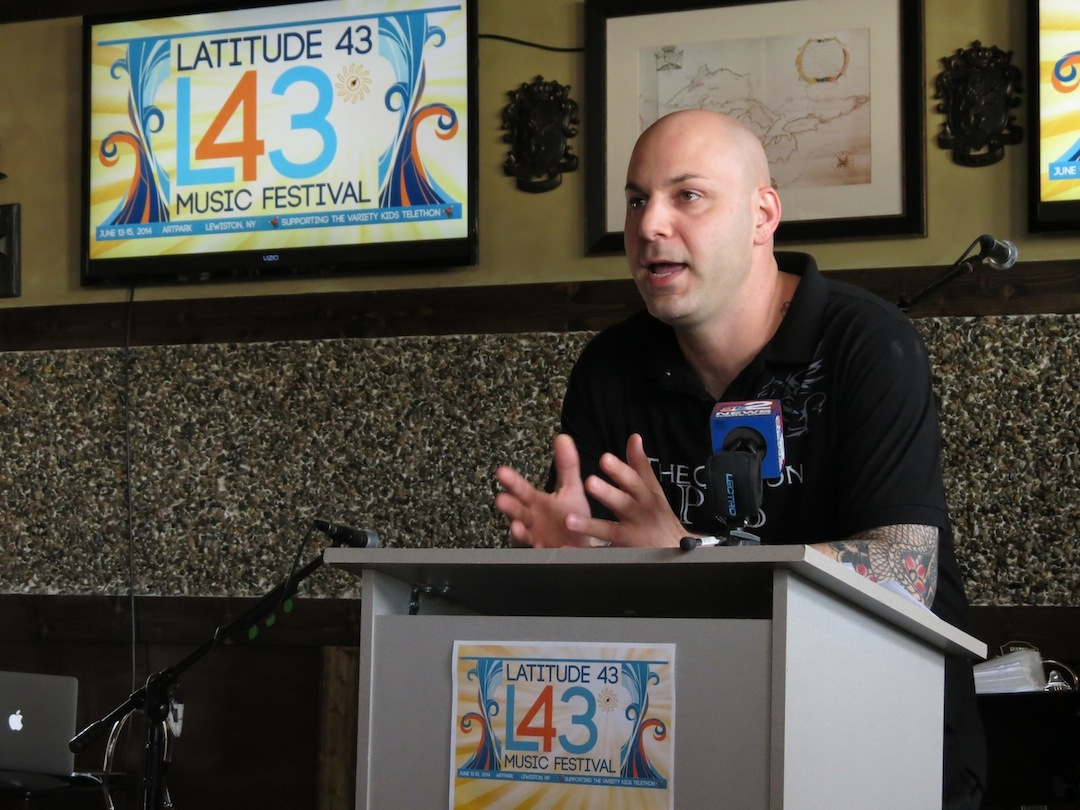 Latitude 43 Music Festival organizer Ken Scibetta unveils the lineup at a press conference Monday at The Griffon Gastropub.