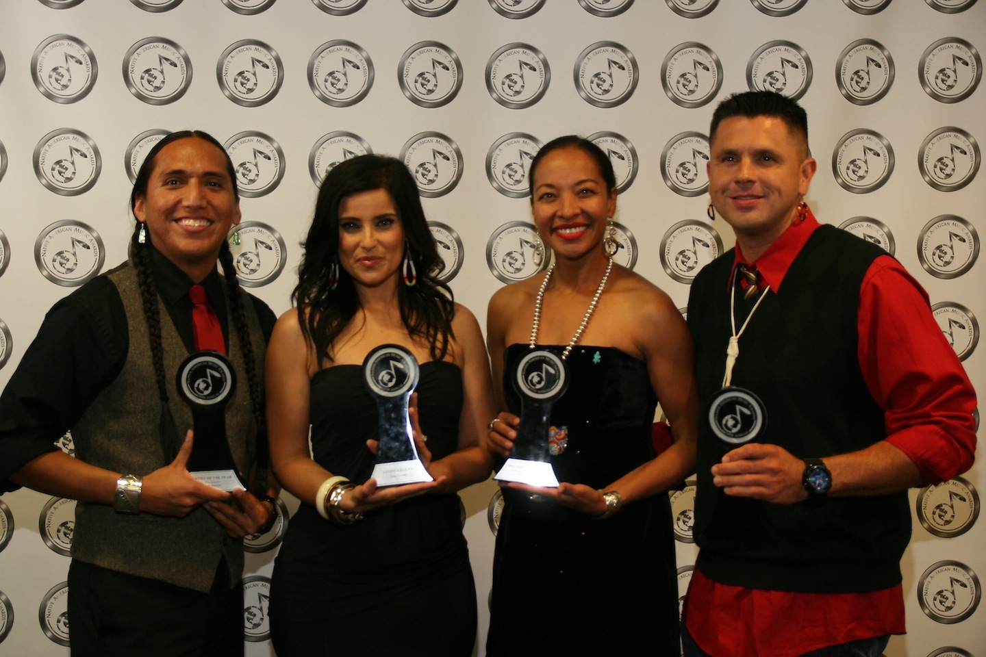 Living Legend Award winner Nelly Furtado, second from left, is shown with Tony Duncan (Performer of the Year), Radmilla Cody (Record of the Year) and Wayne Silas Jr. (Best Male Artist). (photo by Kim Acosta/NAMA)
