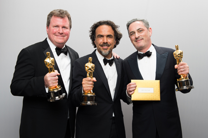 Academy Awards: Pictured, from left: James W. Skotchdopole, Alejandro G. Iñárritu and John Lesher pose backstage with the Oscar for Best Motion Picture of the Year. They won for