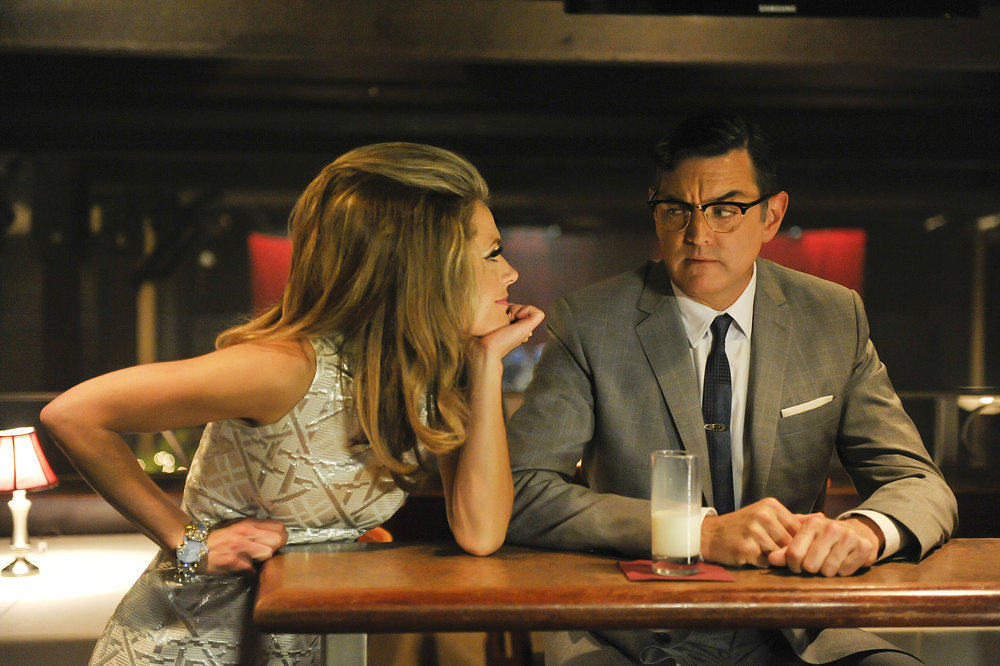 `Psych` `1967: A Psych Odyssey`: Pictured are Maggie Lawson as Juliet O'Hara and Timothy Omundson as Carlton Lassiter. (USA Network photo by Alan Zenuk)