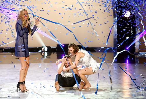 `So You Think You Can Dance` season 11 finale: Host Cat Deeley, left, announces winning contestant Ricky Ubeda, center, with runner-up Valerie Rockey. (FOX photo by Adam Rose)