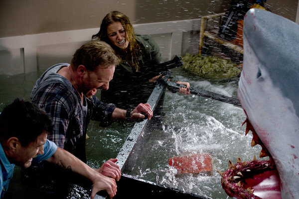 `Sharknado`: Pictured, from left: Ian Ziering's Fin and Cassie Scerbo's Nova fight off a foe. (Syfy photo)