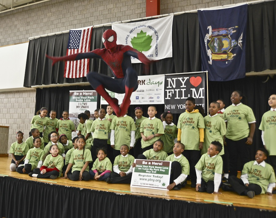 Spider-Man works with children at Riverbank State Park to encourage youth volunteerism on `I Love My Park Day.` (submitted photo)