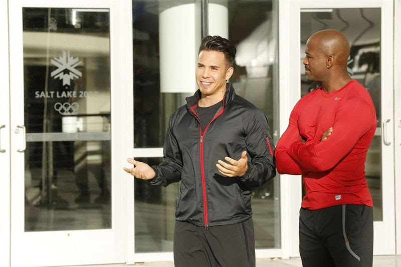Apolo Ohno talks as trainer Dolvett Quince looks on during a special episode of `The Biggest Loser` on NBC. (NBC photo by Trae Patton)