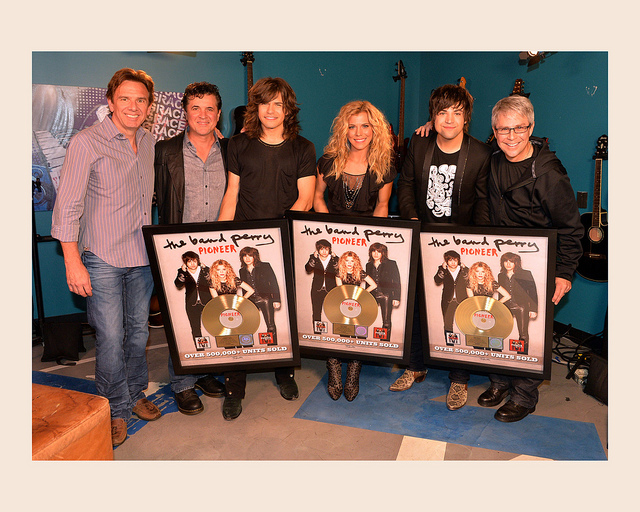 Pictured, from left: Dann Huff, Scott Borchetta, Reid Perry, Kimberly Perry, Neil Perry and Jimmy Harnen. (photo by Rick Diamond)