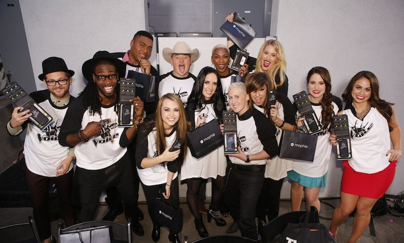 `The Voice`: Pictured, from left:  Josh Kaufman, Delvin Choice, T.J. Wilkins, Bria Kelly, Jake Worthington, Kat Perkins, Sisaundra Lewis, Kristen Merlin, Christina Grimmie, Dani Moz, Audra McLaughlin and Tess Boyer perform Tuesday at the top 12 artists concert at City Walk in Universal City, Calif. (NBC photo by Trae Patton)
