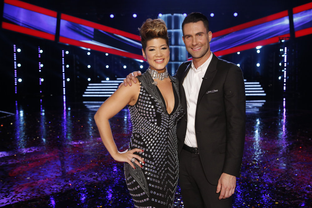 """The Voice"" champion Tessanne Chin stands with her coach, Adam Levine. (NBC photo by Trae Patton)"