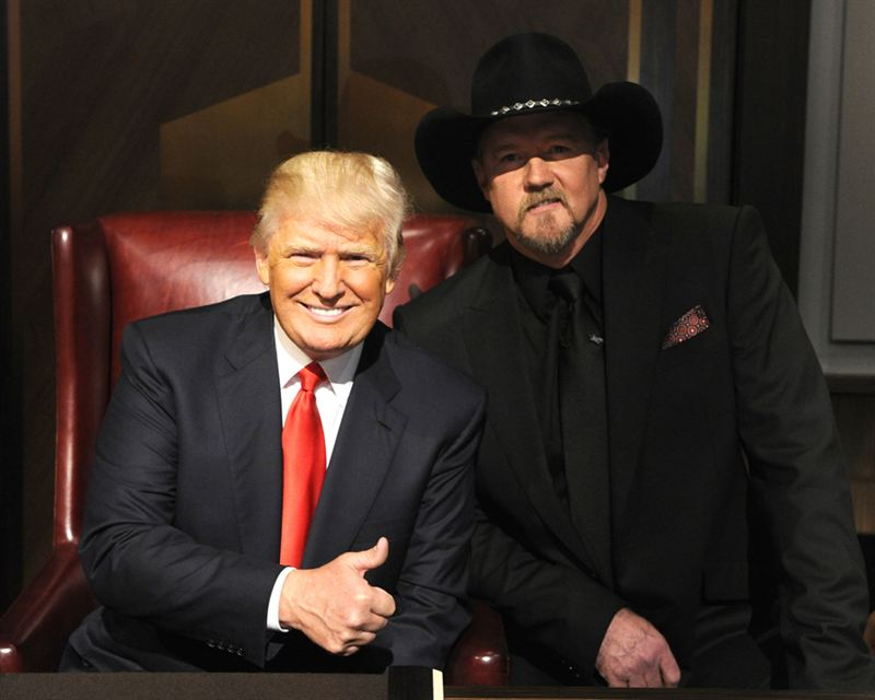 Donald Trump (left) poses with `All-Star Celebrity Apprentice` winner Trace Adkins. NBC photo by Virginia Sherwood.