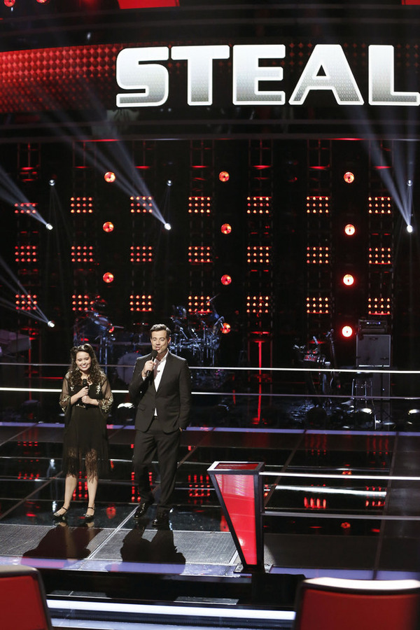 """The Voice"": Hannah Kirby is stolen as host Carson Daly looks on. (NBC photo by Tyler Golden)"