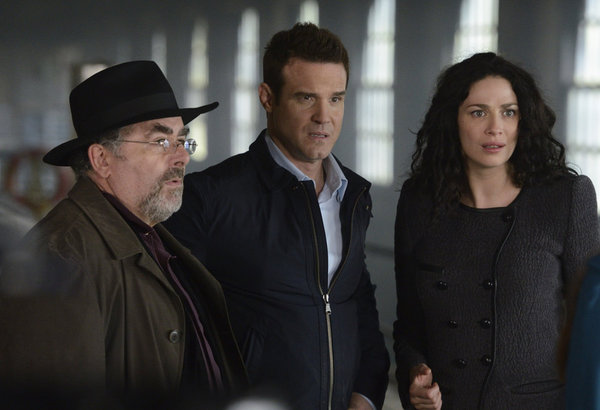 `Warehouse 13`: Pictured, from left, are stars Saul Rubinek as Artie Nielsen, Eddie McClintock as Pete Lattimer and Joanne Kelly as Myka Bering. (Syfy photo by Steve Wilkie)