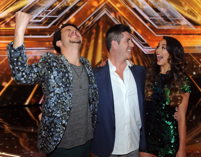 `The X Factor` finale: Simon Cowell, middle, and winners Alex & Sierra. (FOX photo by Ray Mickshaw).