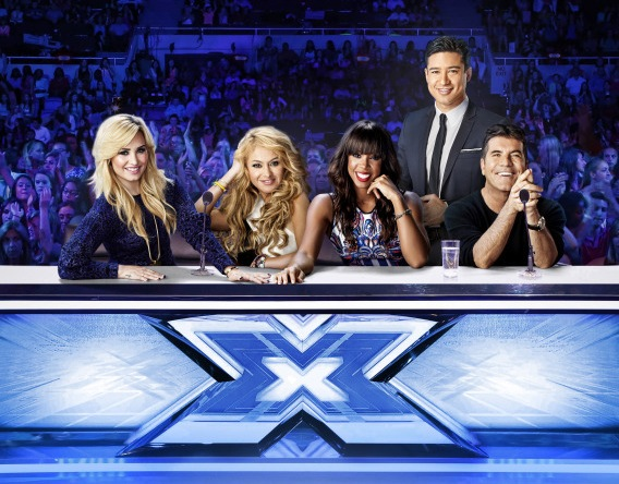 `The X Factor`: Pictured, from left: Demi Lovato, Paulina Rubio, Kelly Rowland, Mario Lopez and Simon Cowell on `The X Factor,` season three, on FOX. (FOX photo by Nino Munoz)