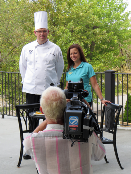 Wegmans (Military Road) event coordinator Jill Feistel and chef Jamie Walkowiak prepare for their time on camera. Below, Walkowiak holds a delicious dish.