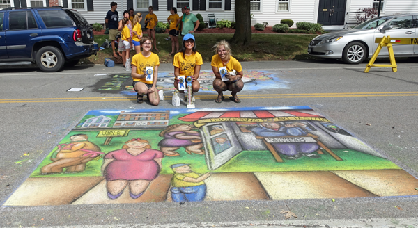 From left, Julie Klein, Lovepreet Kaur and Lex Hy of Grand Island received the blue ribbon for best chalk mural in the Chalk Walk competition Saturday at the Lewiston Art Festival. (Photo by K&D Action Photo and Aerial Imaging)