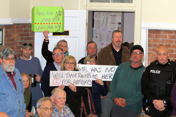Almost three-dozen people attended Monday's Village Board work session to peacefully promote racial equality.