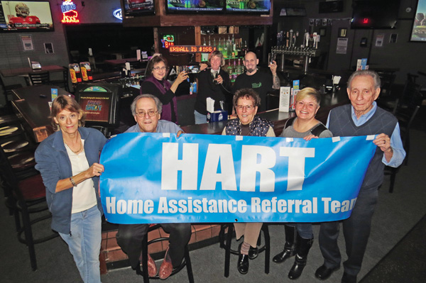 Pictured, from left, front row, are Tracy Gillick of Hill-Vue Café, Tom Pieroni of Summer of '69 All-Star Band, Irene Elia of HART, Cheryl Pfohl of The Stone Jug and Art Ponzi of Macri's. Back row, from left: Judy Tederous of HART, and Kim Cudmore and Tony Ramsey of the Lewiston Event Center. Shown below, Pieroni performs for the volunteers. (Photos by Joshua Maloni)