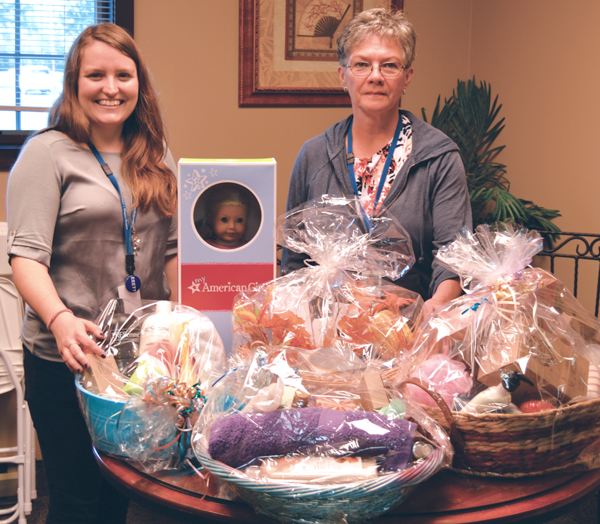 Niagara Hospice volunteer coordinator Lisa Schmidt, left, and Niagara Hospice volunteer Mary Dixon prepare for the 26th annual `Cocktails & CA$H` fundraiser, set for Oct. 21at the Cambria firehall. Gift baskets will include spa and restaurant gift certificates, an autographed Jack Eichel hockey stick and a Sony PlayStation.