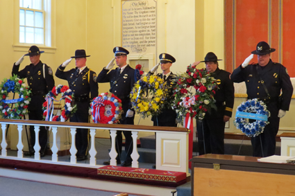 Shown is a scene from the Niagara Interfaith Chaplaincy Police Memorial Service. 2016 Pictured is a display of wreaths in honor of those on the Roll of Honor.