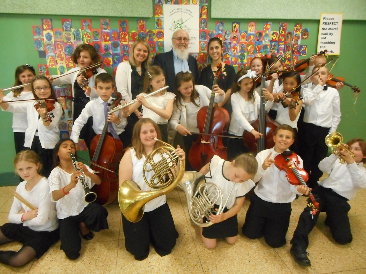 Pictured, from left: Jill Carere-Fetterman, Tim Henderson of Instruments for Peace, Falynn Spinnegan and Lewiston-Porter fourth-grade band and orchestra.