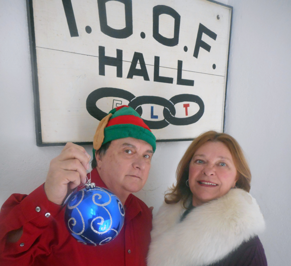 Dale Campbell and Kathryn Serianni begin decorating for the Lewiston Christmas Walk.
