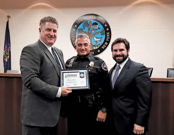 Town Supervisor Steve Broderick, left, with Lewiston's `Safest Place to Live` designation, joined by LPD Chief Frank Previte and Town Councilman Al Bax. (Photo by Terry Duffy)