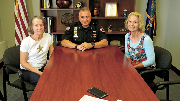 Lewiston Police Department Chief Frank Previte is shown with fundraiser organizers Arlene Sliz, left, and Claudia Marasco.