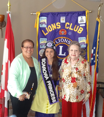 Tuscarora Princess Jazlin Kirkland is flanked by her grandmother, Janice Printup, and Lewiston Community Lions Club member Theresa Tourbin.