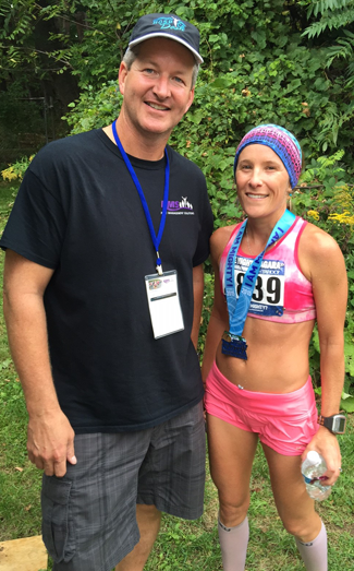 Mighty Niagara Half Marathon Race Chairman Paul Beatty Jr. is shown with 2015 overall female winner, Natasha Yaremczuk, whose race time was 1:21:16.