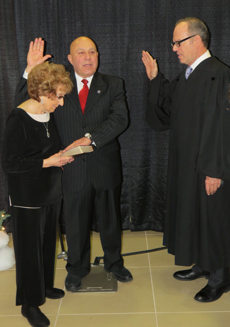 Former North Tonawanda City Judge Joseph Cassata performed the ceremony, as Morinello's mother, Mary Certo-Rolle, held the Bible.