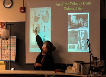 Niagara County Historian Kate Emerson presents historic details of the men's 18th century waistcoat to Niagara University students as a contributor to a collaborative project between Old Fort Niagara and the university.