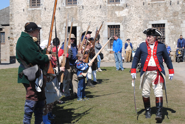 Thomas Thompson, right, of Hoisington's New York Rangers, portrays an officer of the Continental Army and urges visitors to rebel from British control and fight as patriots. (Photo by Charlotte Clark)