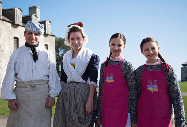 Old Fort Niagara's Brian McDonald (interpretive department assistant manager) and Suzannah Emerson (interpreter) pose with `Twice as Good` twin hosts Delaney and Hadley.