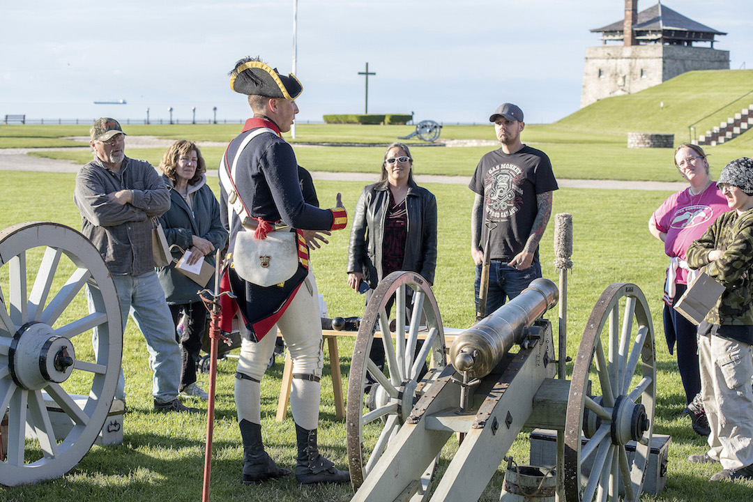 Regional residents learn about artillery from Lee Gugino in the fort's interpretation department at Old Fort Niagara's community night. (Photo by Wayne Peters)