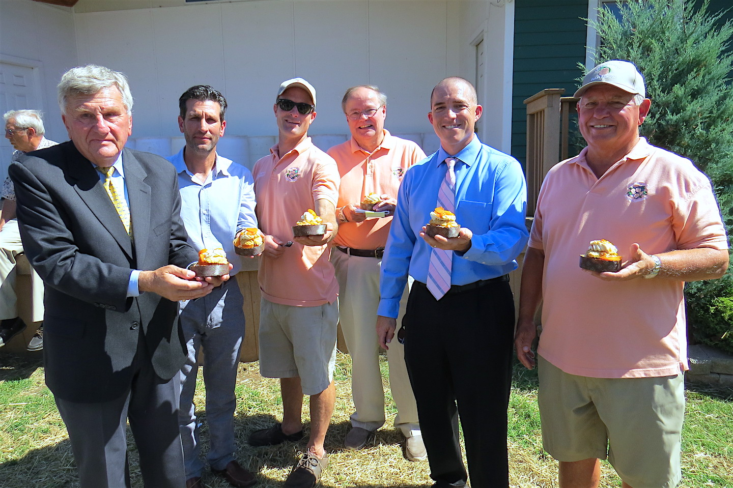From left: Veteran Peach Festival Advisory Chairman Jerry Wolfgang, Niagara Falls Culinary Institute Division Chairman Mark Mistriner, Peach Festival Chairman Alan Hastings, Kiwanis Club of Lewiston President the Rev. Tom Mason, Former President Marty Pauly and 5k Run Chairman Randy Gorzka addressed the media Wednesday, as local leaders provided support. Following the briefing, samples of the Peach Festival's famous peach shortcake were distributed.