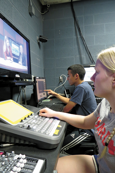 Niagara Falls High School seniors and Our Schools Channel media interns Allie Hubert and Christian Meranto work on a