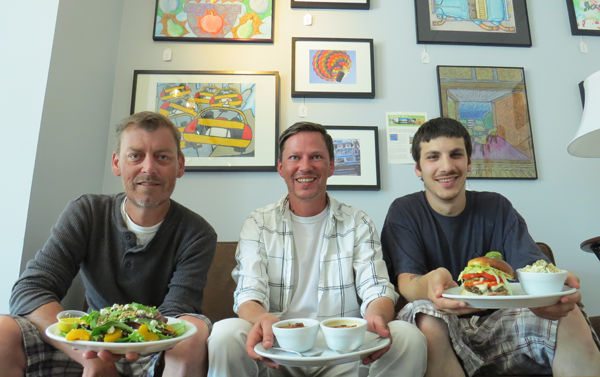 Pictured, from left, inside of Scott's Corner Art Bistro, John Caldwell, Scott Struzik and Derek Clark hold some of the eatery's top menu items, including `The Artsy` salad, `Drunken Chili` and creamy tomato bisque (also shown below), and the classic burger.