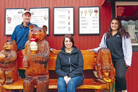 Pictured, from left, along with the famous Silo bears outside the caboose, are Alan Hastings, Stacey Sheehan and Lexi Alfiere