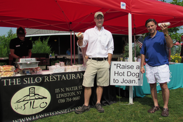 Alan Hastings and Joseph Pillittere Jr. `Raise a Hot Dog to Joan` in this file photo.