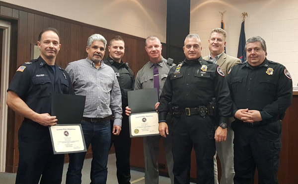 Lewiston Police Department Chief Frank Previte offered praise to area first responders in working quickly to save the life of retired State Trooper Ricardo Flores (second from left) from a near-fatal bee sting in 2015. (Photo by Terry Duffy)