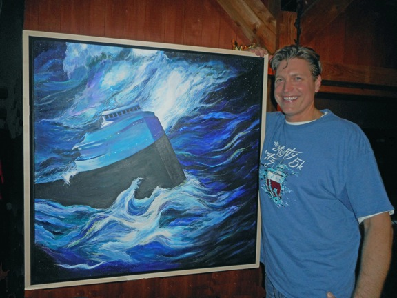 SS Edmund Fitzgerald enthusiast Thomas Paul Asklar with his painting, `The Witch of November.`