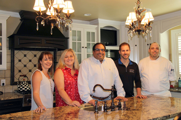 Pictured, from left: interior designer Julie DeAngelo of Bridge Interiors, Marla and Jeffrey Williams (homeowners of `The Rice Residence), and Legends Bar & Grill) Manager Michael Masseo and executive chef Shawn LeVick.