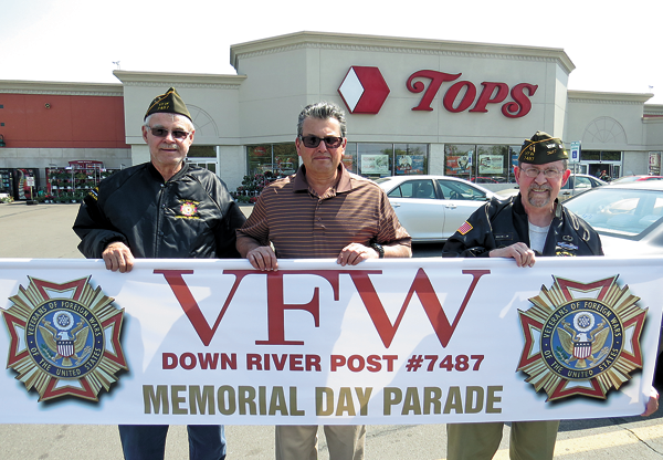 Shown holding the Veterans of Foreign Wars Downriver Post 7487 banner are, from left, Cmdr. Bill Justyk, DiMino Tops Lewiston owner Anthony DiMino, and Adjutant Norm Machelor. (Photo by Joshua Maloni)