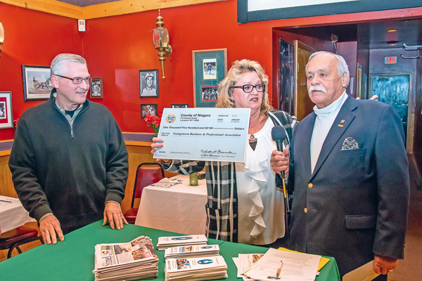 Clyde Burmaster offers remarks as YBPA's Cheryl Butera holds a check Burmaster presented. At left is YBPA Secretary Mark Butera. (Photo by Wayne Peters)