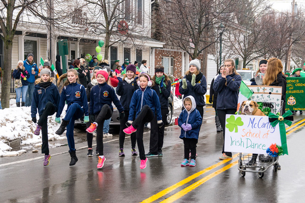The McCarthy School of Irish Dance on the parade route, with the dancers' prize-winning float. (Photo by Wayne Peters)