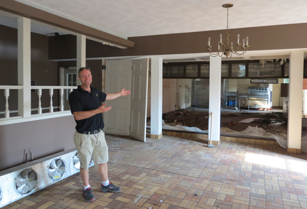 Alan Hastings stands inside the Frontier House in this 2013 file photo. The Town of Lewiston is considering purchasing the building from Alan's father, Richard.