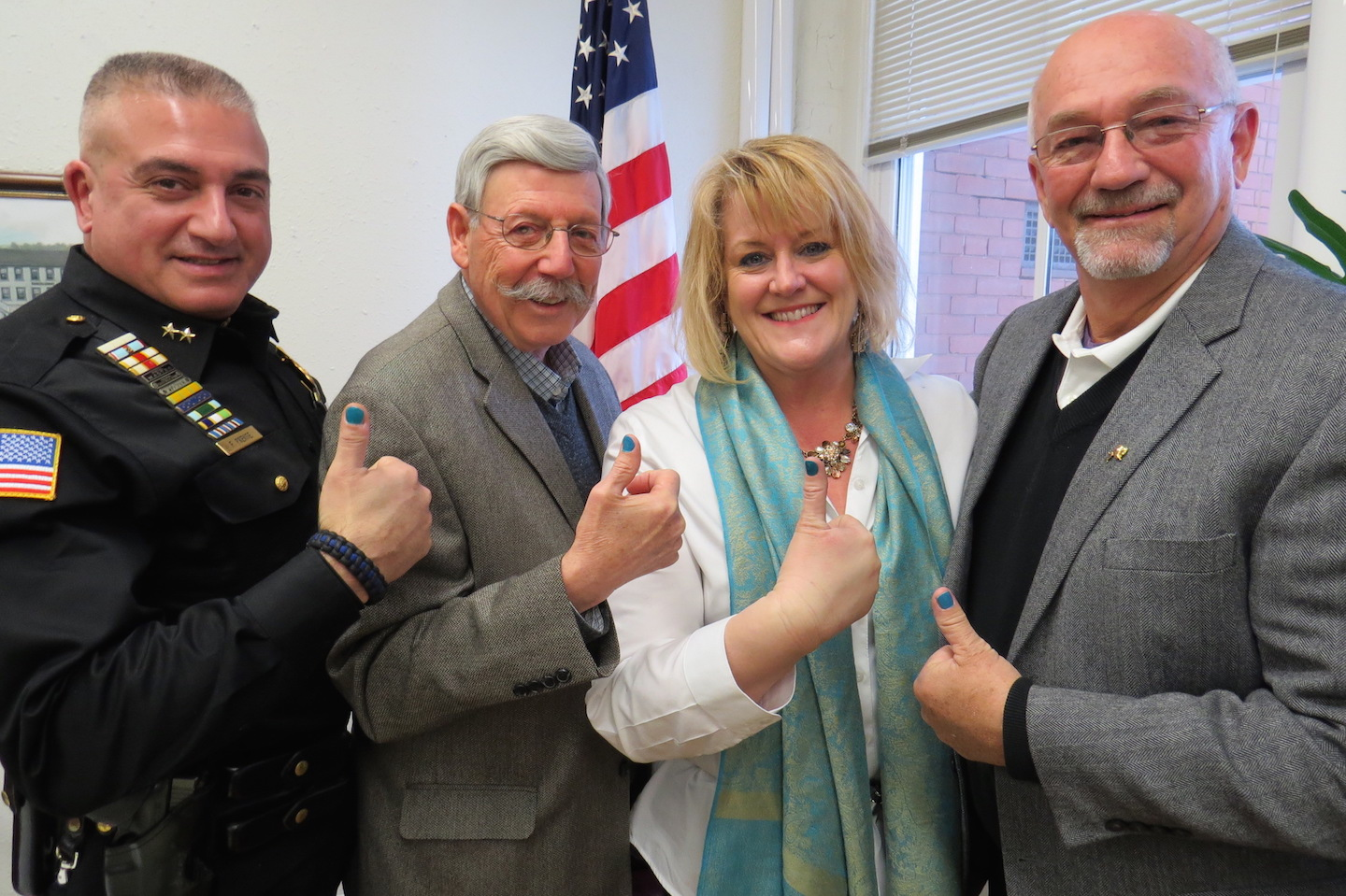 Pictured, from left, giving a teal thumbs up, are LPD Chief Frank Previte, Mayor Terry Collesano, It Happened to Alexa Foundation Executive Director Sandra Lahrache and Deputy Mayor Bruce Sutherland.