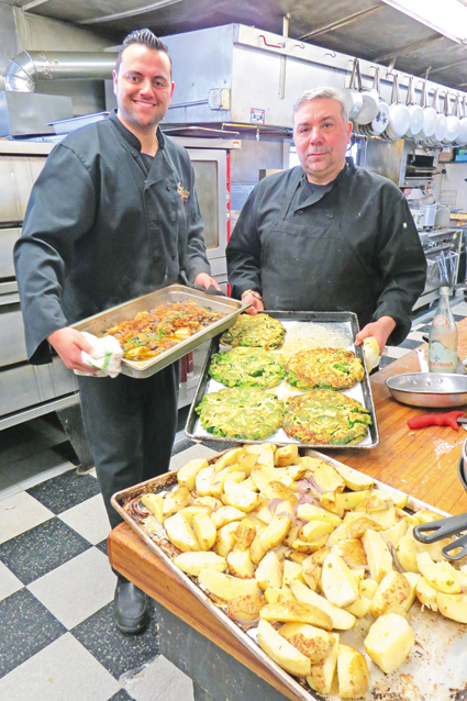 Chefs Charlie and Jack Soldano are shown inside the Casa Antica kitchen during last year's St. Joseph Day table. The popular event, which features many different dishes, returns Sunday, March 20.