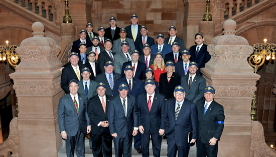 Assemblyman John Ceretto and fellow members of the Assembly wear NYPD hats and stand in support of the New York State Police inside the Capitol in Albany.