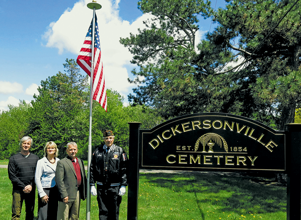 Pictured, from left, Town of Lewiston Historian Bob Martinez, Clerk Donna Garfinkel, Supervisor Dennis Brochey and VFW Downriver Post No. 7487 Deputy Commander Larry Stephens are shown beside the new flagpole at Dickersonville Cemetery. (Click for a larger image)