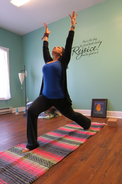 Annie Rychlik practices yoga at her Down Dog studio in Lewiston.